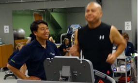 Anthony Luke, MD, assesses the running biomechanics of Harold  Guzman, a client
