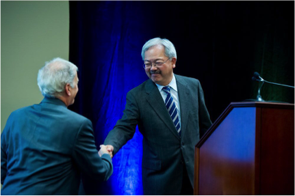The Honorable Edwin Lee (right), mayor of the City and County of San Francisco, introduces Warren Browner, MD, MPH, chair of the San Francisco section of the Hospital Council of Northern and Central California, at the 2016 SFHIP Community Health Needs Assessment breakfast on September 27, 2016.