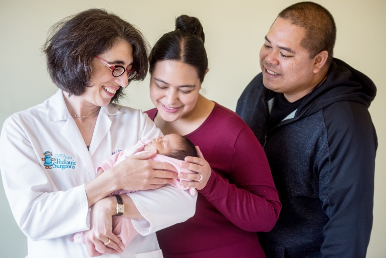 Tippi MacKenzie (left), MD, of UCSF Benioff Children's Hospital San Francisco, visits with newborn Elianna, who received a stem cell transplant before birth